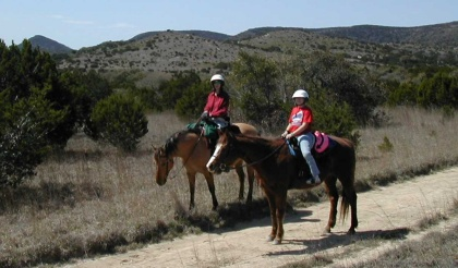 Riding horses in Bandera TX