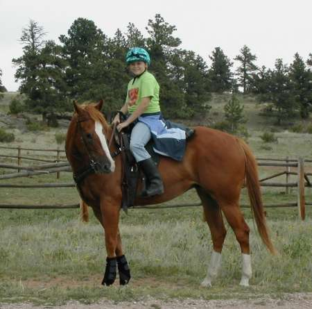 girl riding horse on dude ranch