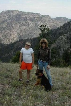 Chris and Kaitlin and Lady hiking in the National Forest