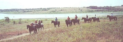 Group trail ride on Texas lake