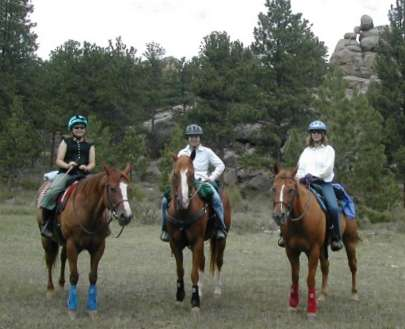 Kaitlin, Alexine and Chris riding in Colorado