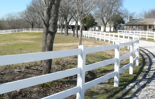 White plastic fence with horses