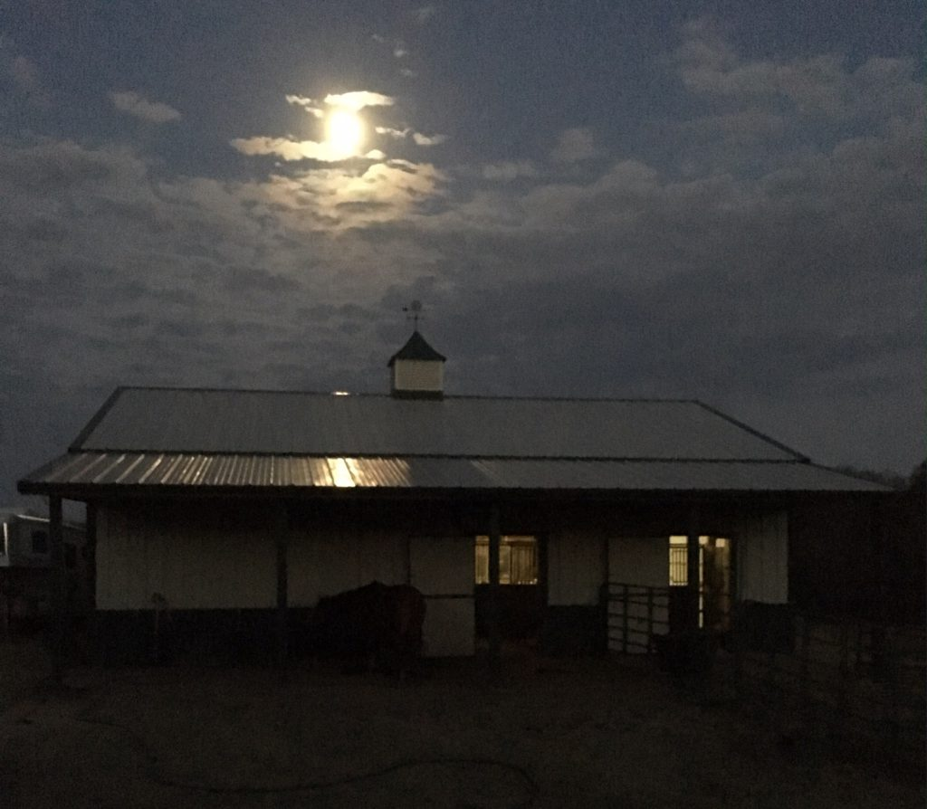 barn with moon overhead